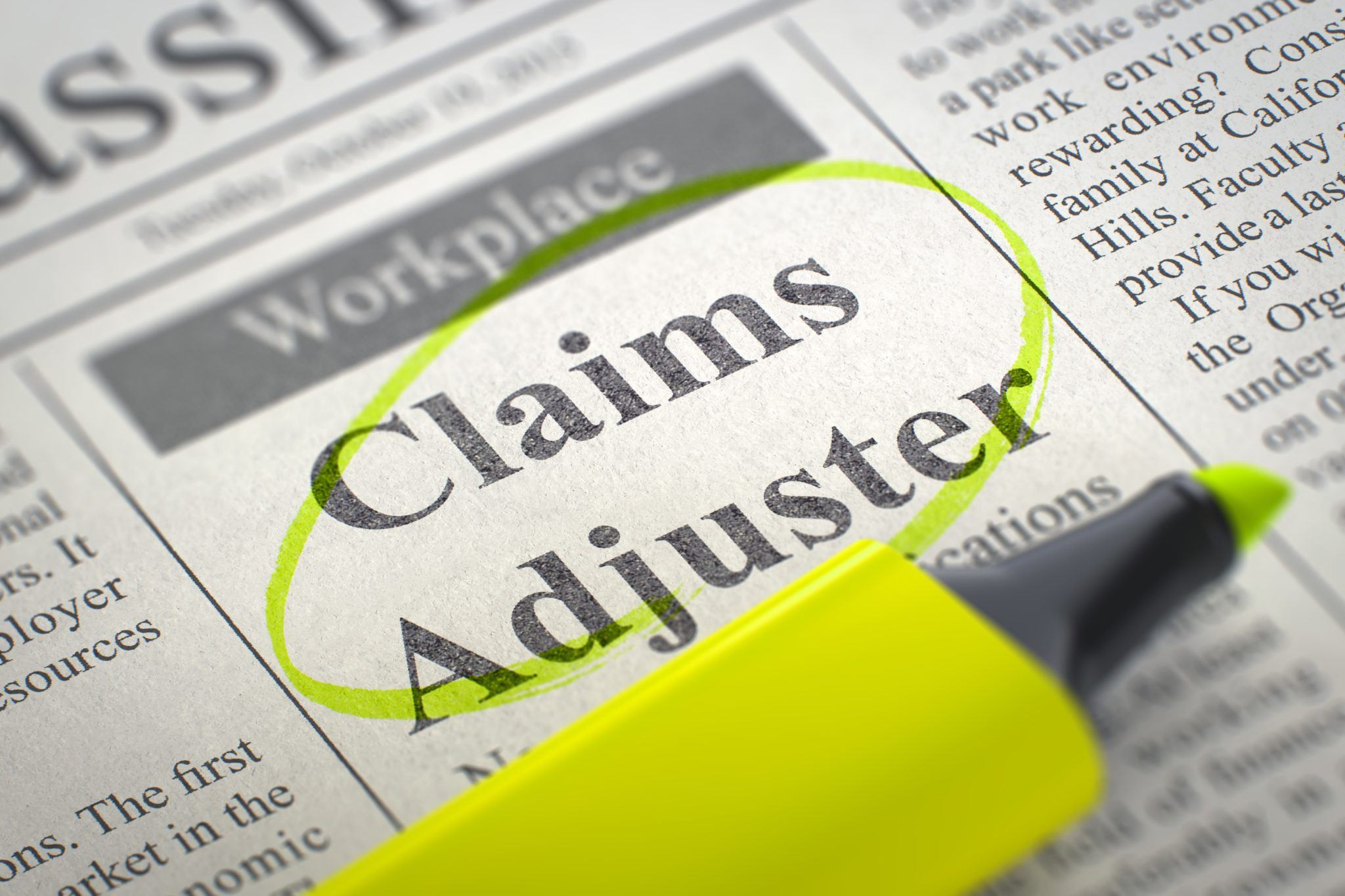 Newspaper with Classified Advertisement of Hiring Claims Adjuster. Blurred Image with Selective focus. Hiring Concept. 3D Render.
