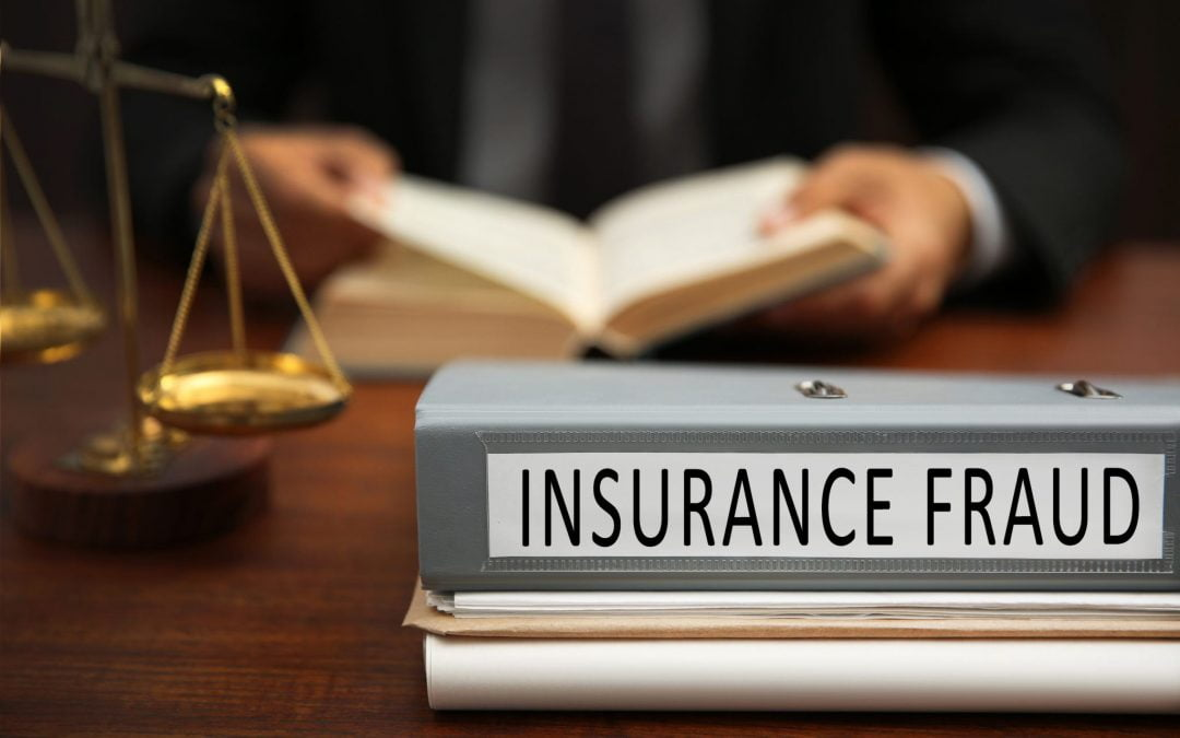 Insurance fraud concept. Folder and man on background