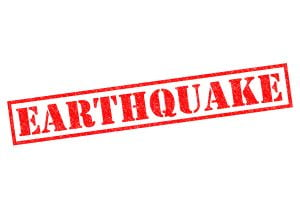 EARTHQUAKE red Rubber Stamp over a white background.