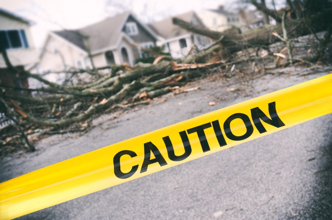 storm damaged area with caution tape