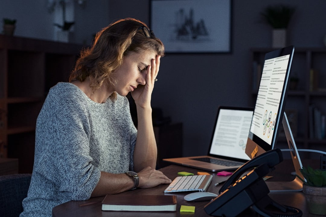 woman at computer with burnout