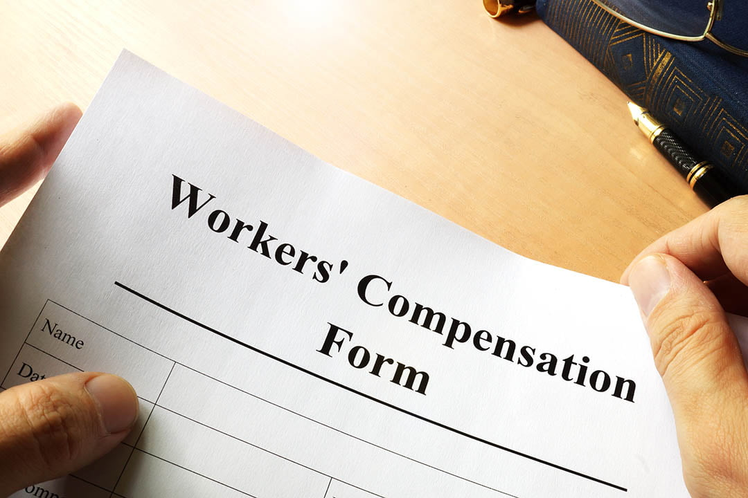 Photo of a workers compensation form on a wood table